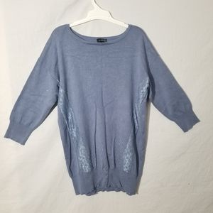 The limited blue long sleeve sweater Sz Large